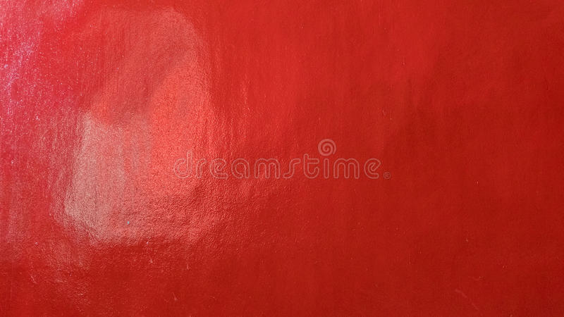 Grungy red marbled ribbed concrete painted wall background. royalty free stock photography