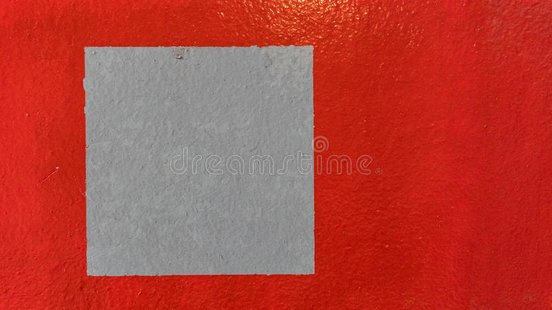 Grungy red marbled ribbed concrete painted wall background. royalty free stock image
