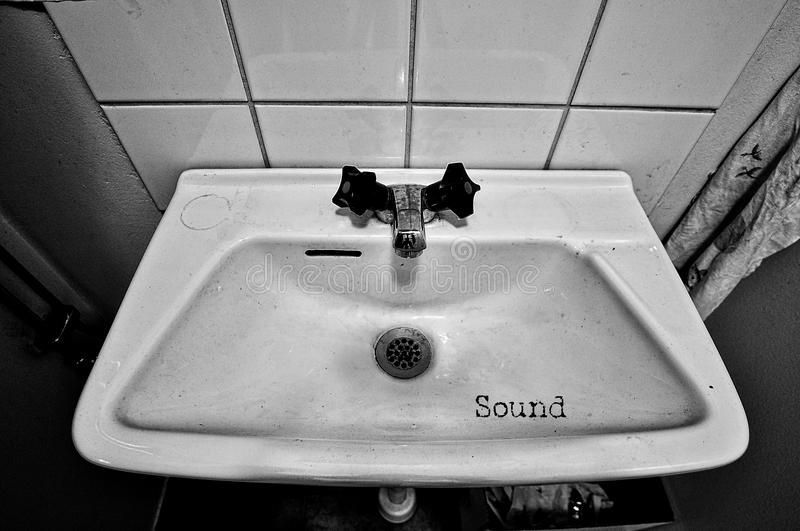 Grungy sink in black and white royalty free stock images
