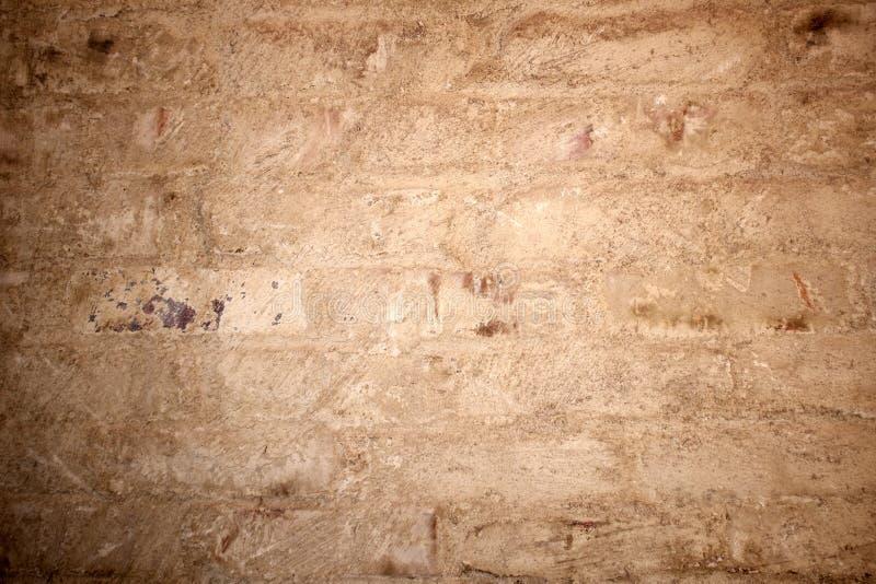 Grungy textur av den målade tegelstenväggen arkivfoto
