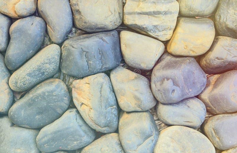 Grungy textura fotográfica con tonalidad de piedra. Fondo de visión superior de las rocas arco iris. Piscina a orillas del sol fotos de archivo
