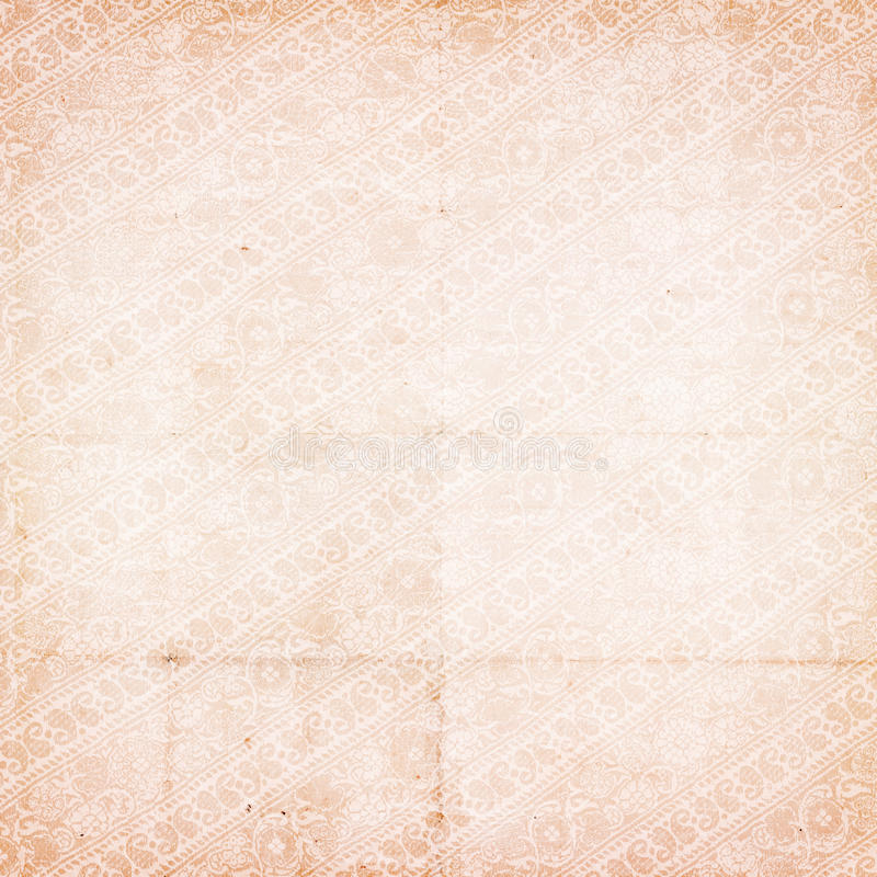 Grungy vintage antique distressed paisley paper. Grungy vintage shabby chic antique distressed paisley paper in soft pink stock image