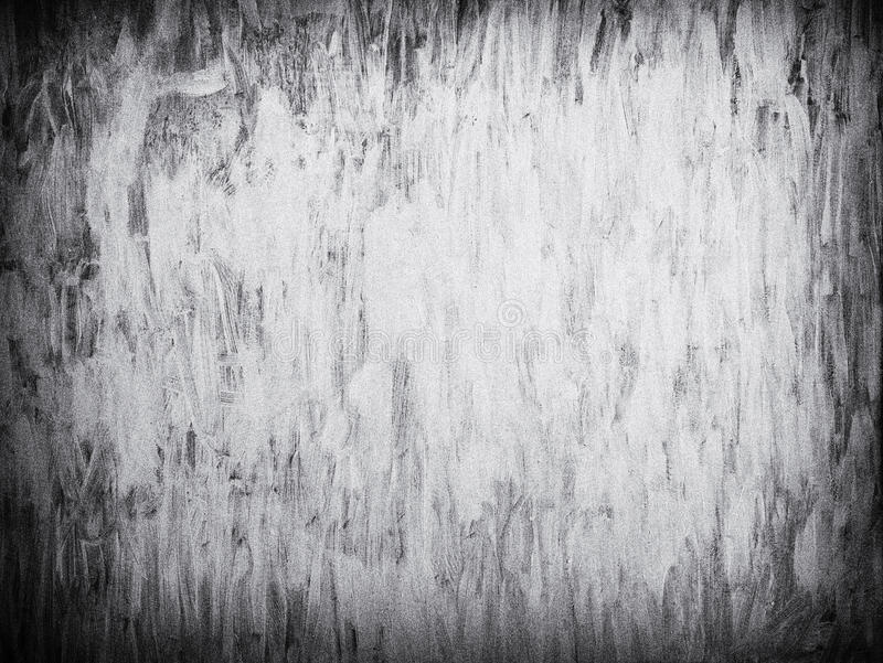Grungy white brush paint background with grain. royalty free stock photography