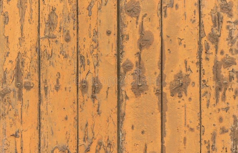 Grungy wood planks orange colored stock photo