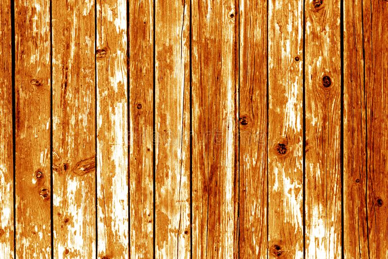 Grungy wooden wall background in orange color. stock images
