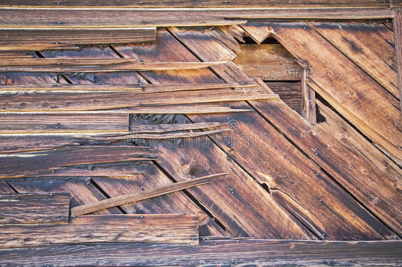 Grungy wooden wall cracked tar paper royalty free stock images