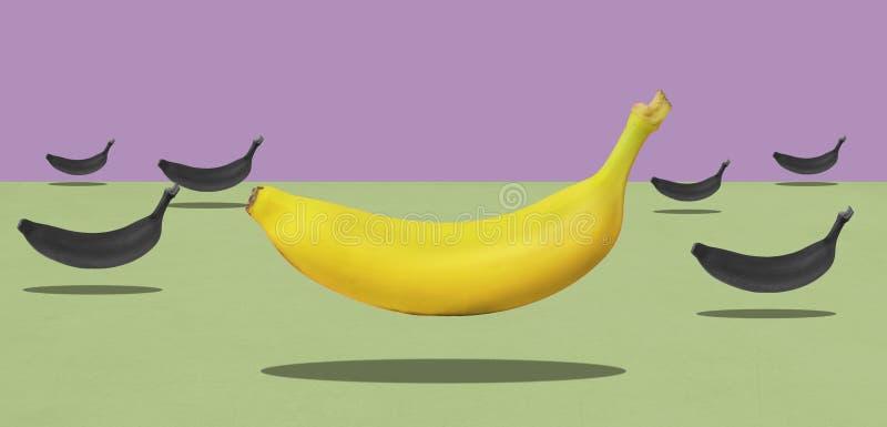 Grupa żółci banany z jeden czerwienią levitate obraz stock