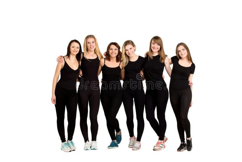 Grupa młode kobiety odizolowywać przy bielem zdjęcia royalty free
