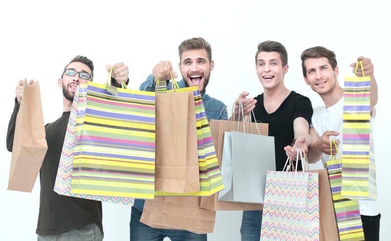 Grupa przyjaciele z torba na zakupy obraz royalty free