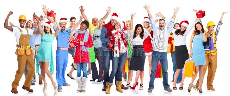Grupa szczęśliwych bożych narodzeń ludzie z prezentami zdjęcia royalty free