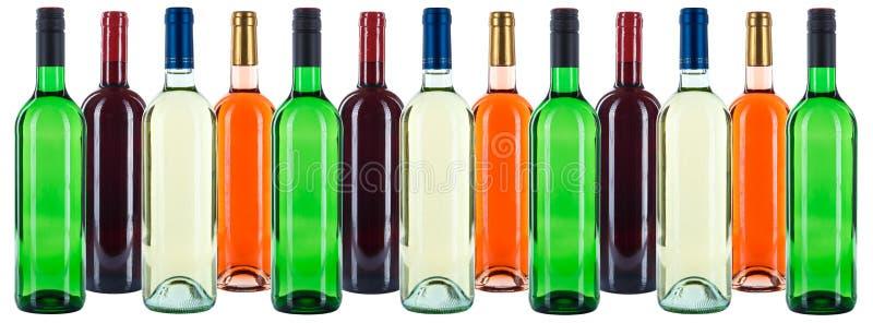 Grupa wino butelek win kolorowego tła bielu czerwona róża ja fotografia stock