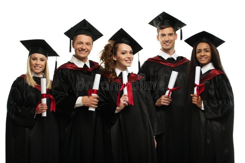 Grupo étnico multi de estudiantes graduados foto de archivo