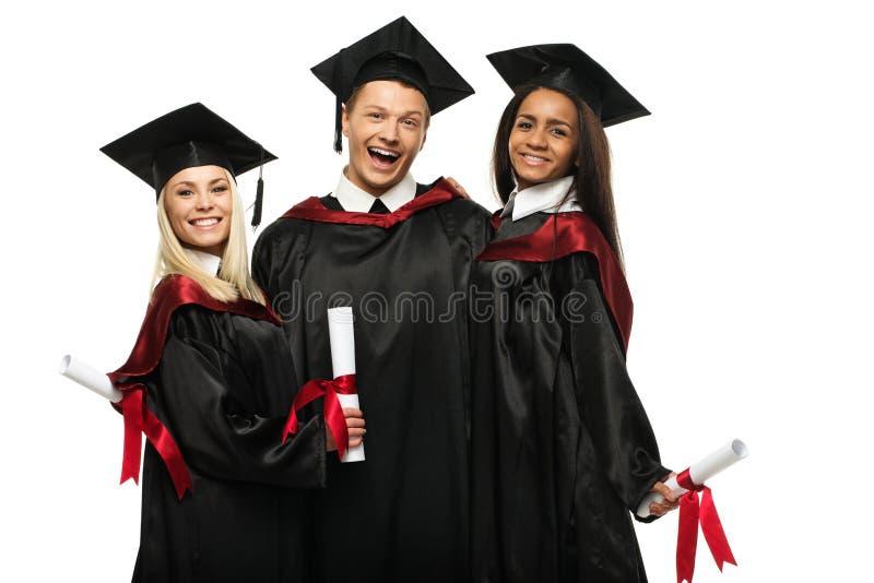 Grupo étnico multi de estudiantes graduados fotografía de archivo libre de regalías