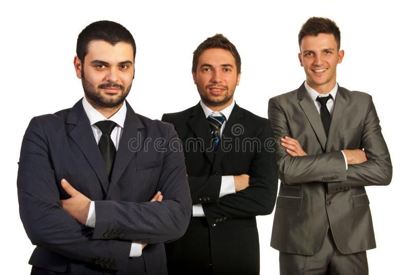 Grupo alegre de três homens de negócio fotografia de stock royalty free