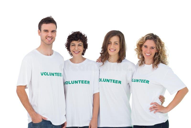 Grupo alegre de voluntários imagem de stock