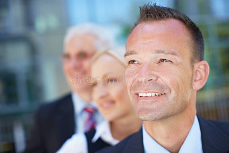 Grupo da equipe do negócio com visão fotografia de stock