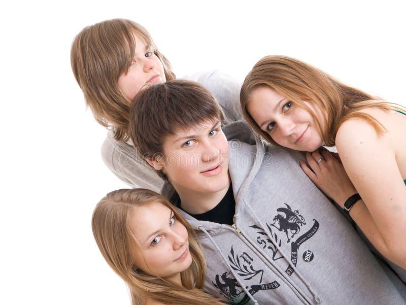 Grupo De Adolescentes Aislados En Un Blanco Fotografía De Archivo