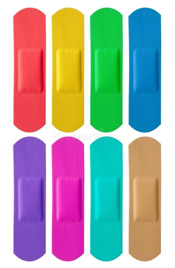Grupo de ataduras médicas coloridas imagem de stock