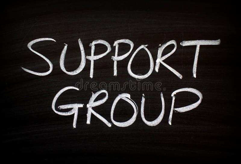 Grupo de ayuda escrito en una pizarra imagen de archivo libre de regalías