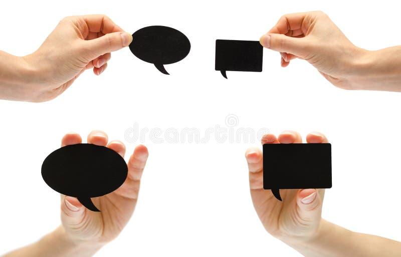 grupo de bolha preta diferente do discurso com mão Isolado no fundo branco imagem de stock