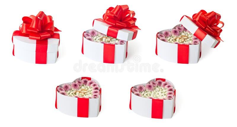 Grupo de caixas de presente dadas forma coração da proposta de união imagens de stock royalty free