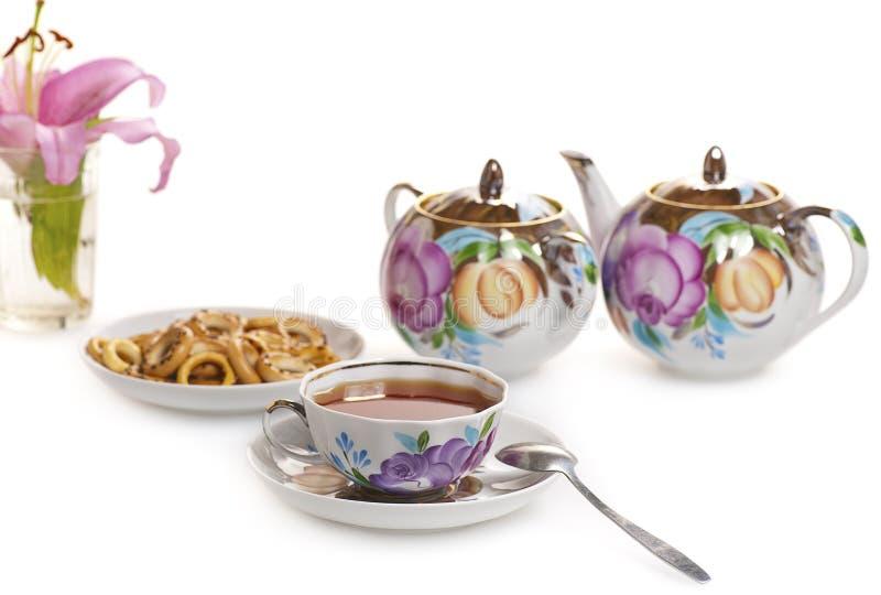 Grupo de chá com teste padrão floral fotos de stock
