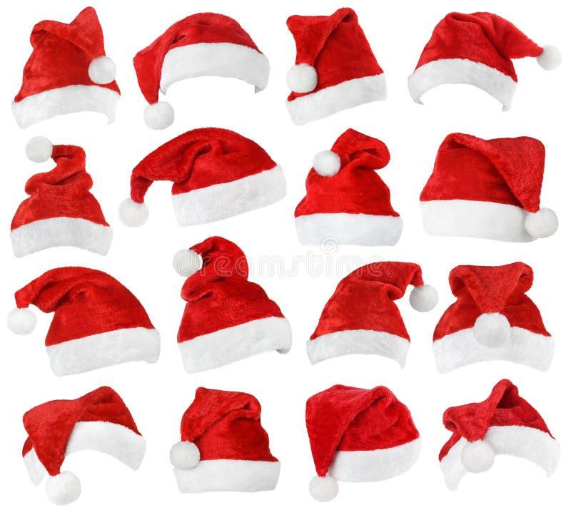 Grupo de chapéus do vermelho de Santa Claus fotografia de stock