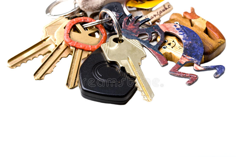 Grupo de chaves da HOME e do escritório em um isola da corrente chave imagem de stock