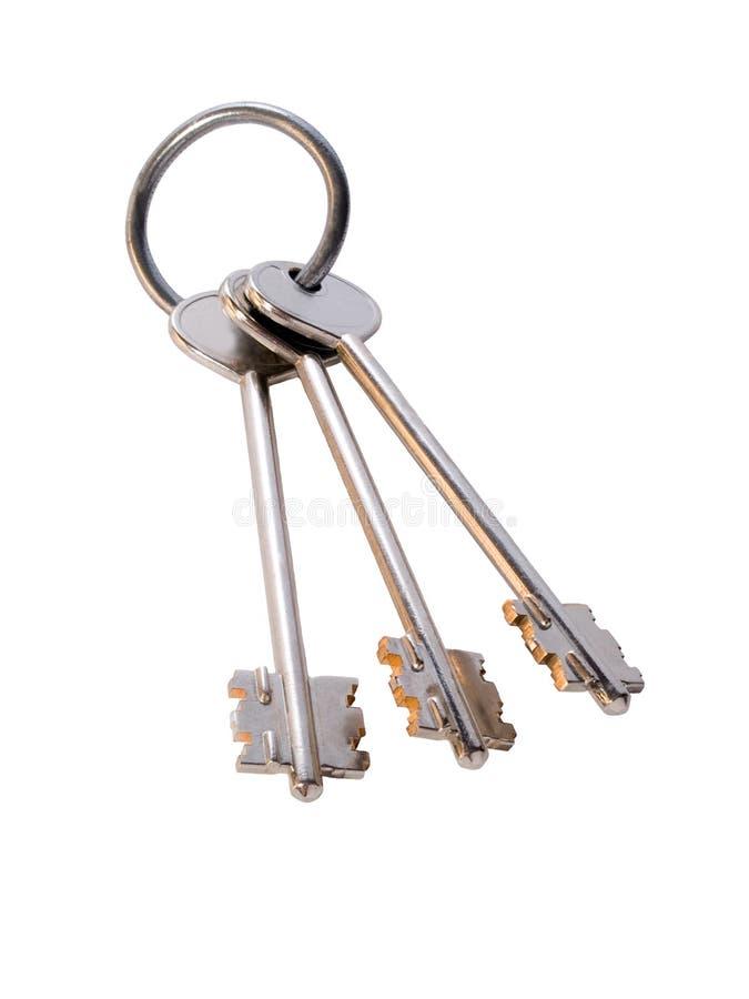 Grupo de chaves douradas no anel imagens de stock royalty free