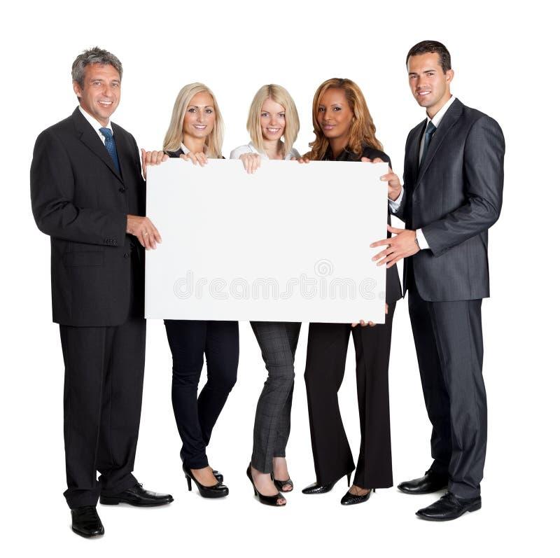 Grupo de colegas felices del asunto imagen de archivo libre de regalías