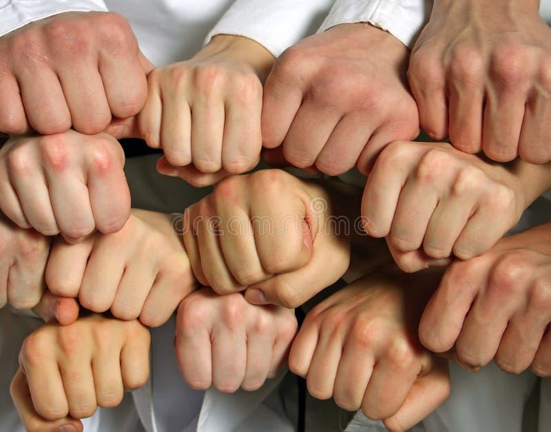 Grupo de concepto de la mano y del negocio y del trabajo en equipo del puño imágenes de archivo libres de regalías