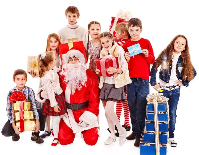 Grupo de crianças com Papai Noel. foto de stock