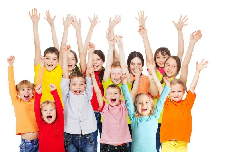 Grupo de crianças felizes de idades diferentes imagem de stock