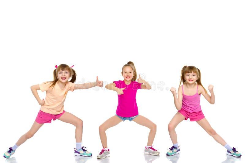 Grupo de crianças mantendo os polegares fotografia de stock