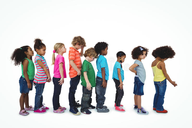 Grupo de crianças que estão em uma linha fotografia de stock royalty free