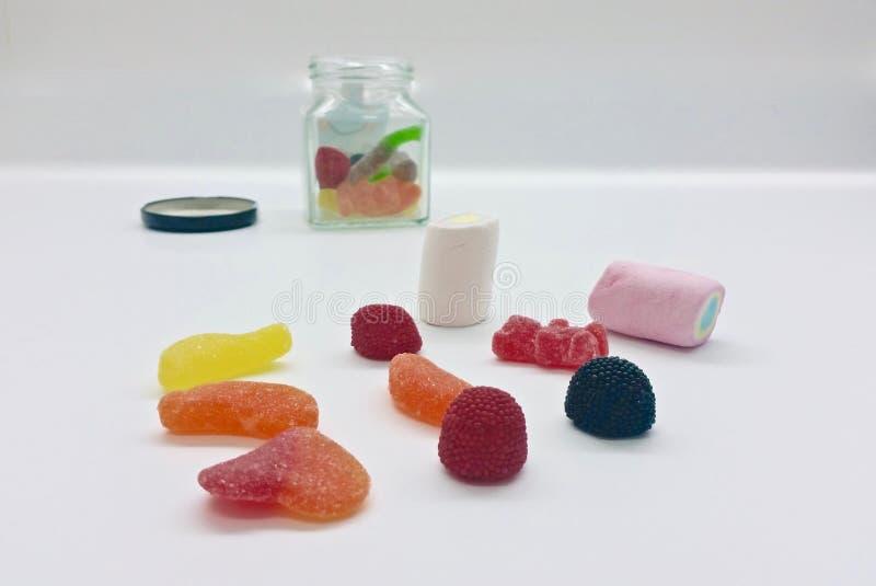 Grupo de doces da geleia com açúcar de vários tipos fotografia de stock