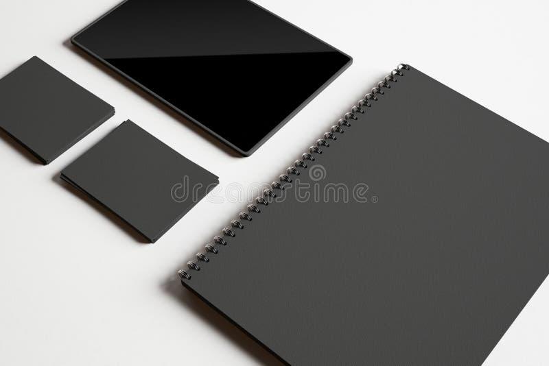 Grupo de elementos e de tabuleta pretos de identidade imagem de stock