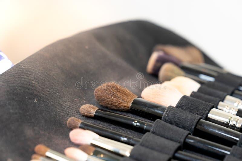 Grupo de escova da composição no saco preto da tela foto de stock royalty free