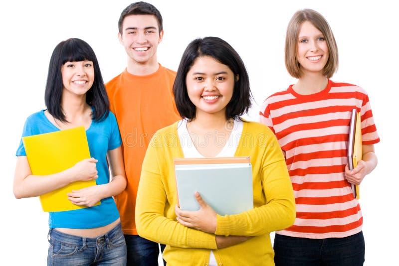 Grupo de estudantes felizes fotografia de stock royalty free