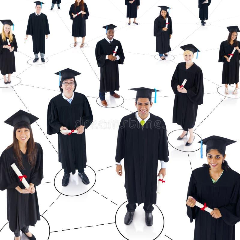 Grupo de estudiantes graduados del mundo imágenes de archivo libres de regalías