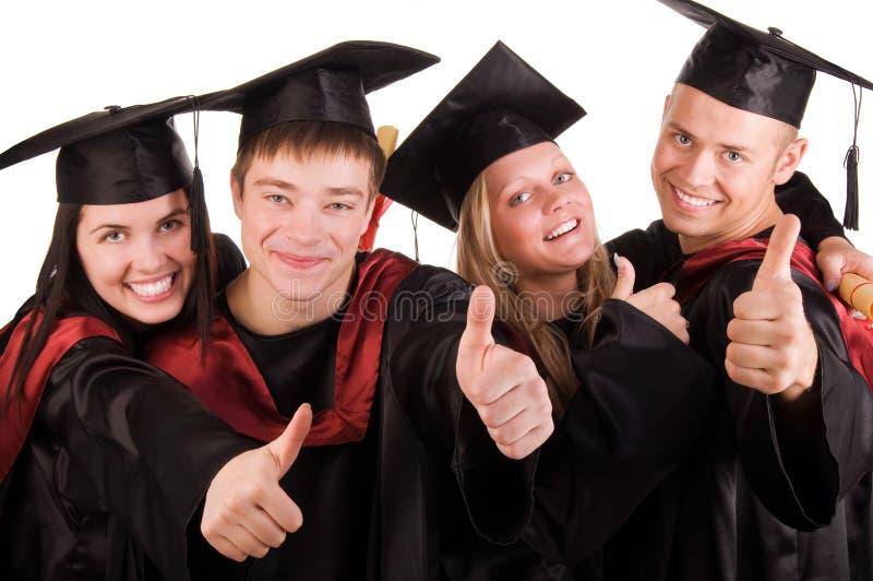 Grupo de estudiantes graduados felices fotografía de archivo