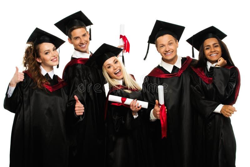 Grupo de estudiantes jovenes graduados imagenes de archivo