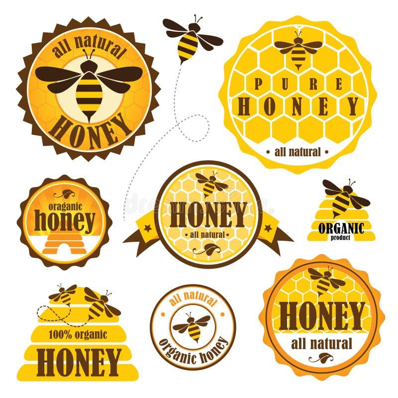 Grupo de etiquetas do mel ilustração stock