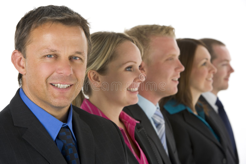 Grupo de executivos em uma linha sorriso imagem de stock royalty free