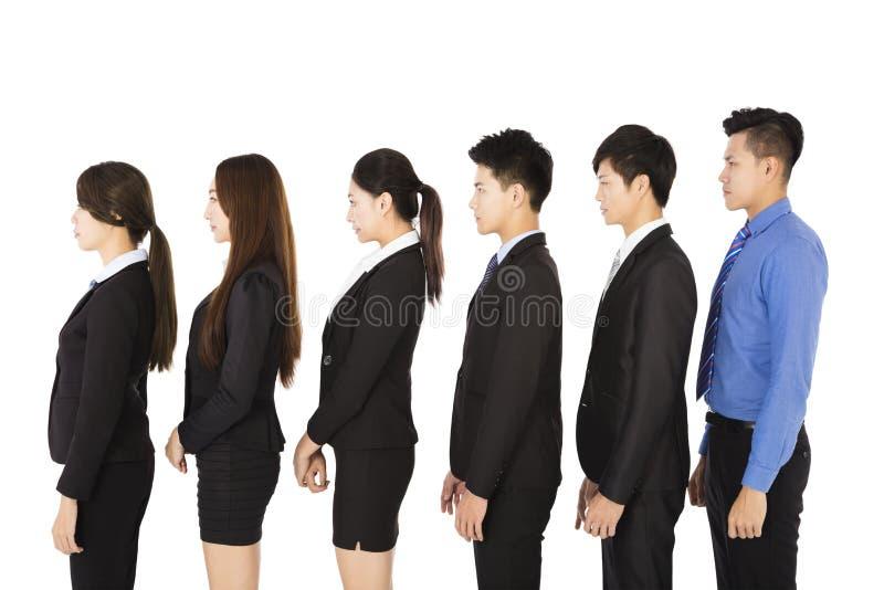 Grupo de executivos que estão na fileira foto de stock royalty free