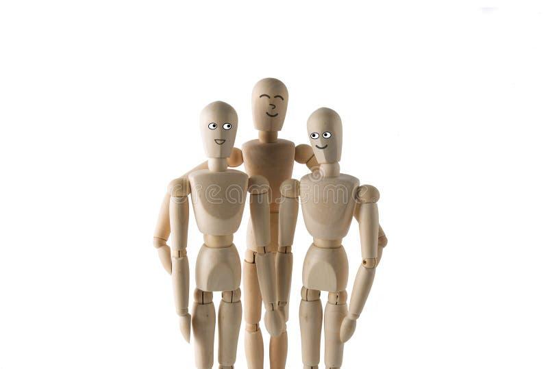 Grupo de fantoches que abraçam e que sorriem foto de stock