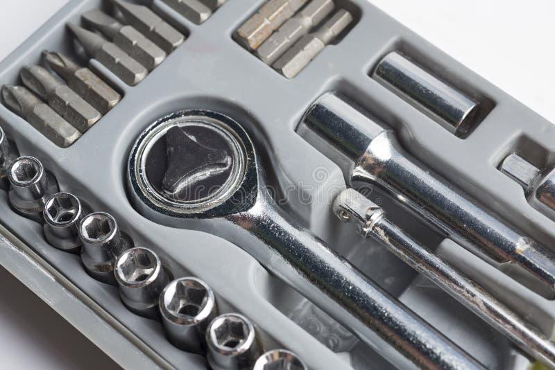 Grupo de ferramentas das cabeças em uma caixa imagens de stock