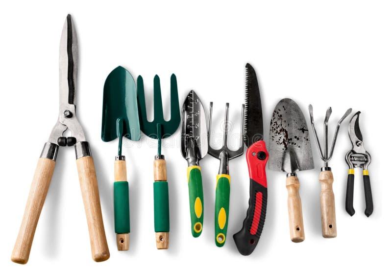 Grupo de ferramentas de jardinagem sobre o fundo branco imagens de stock royalty free