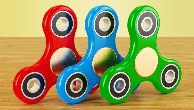 Grupo de giradores coloridos da inquietação na tabela de madeira rendição 3d ilustração stock