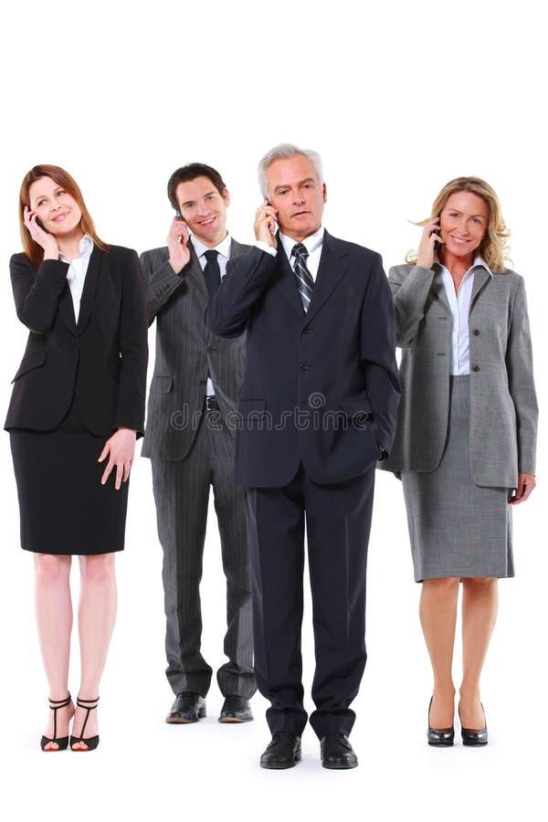Grupo de hombres de negocios con el móvil imagenes de archivo